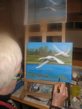 Philip at work on this painting of flying swans