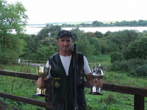 Jimmy with his trophies for skeet shooting.